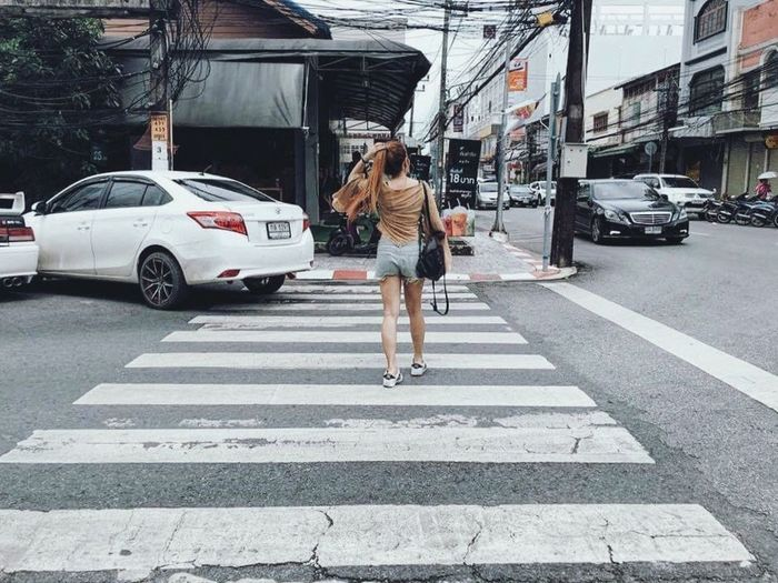 Full length of man crossing road