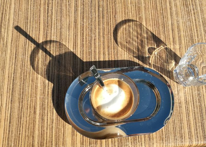 Coffee - Drink Table Coffee Cup Food And Drink Shadow High Angle View Sunlight Refreshment Cappuccino No People Freshness Directly Above Spoon Drink