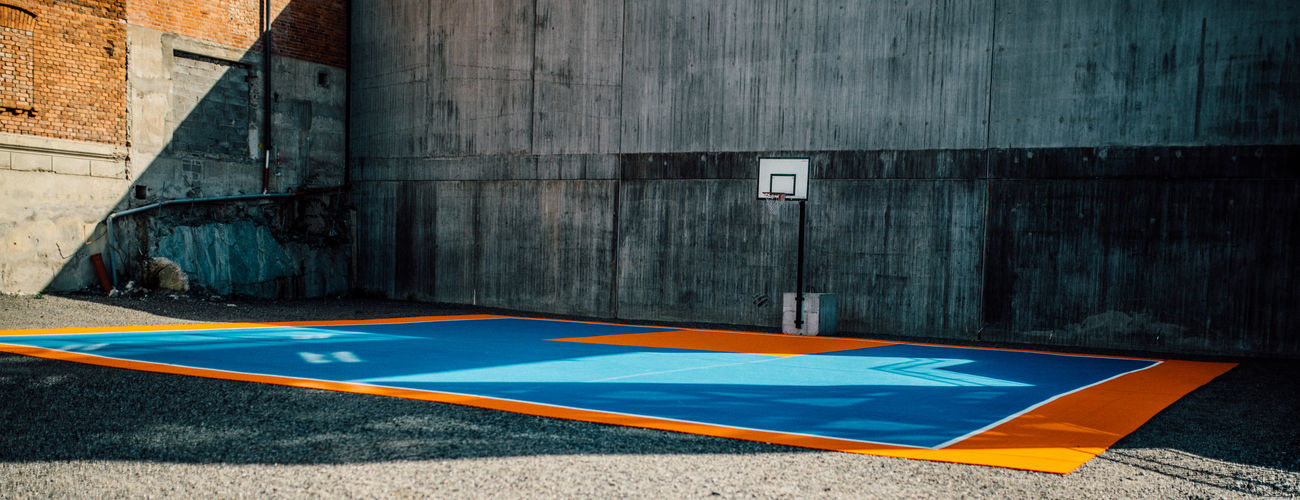 Panoramic view of basketball court by wall