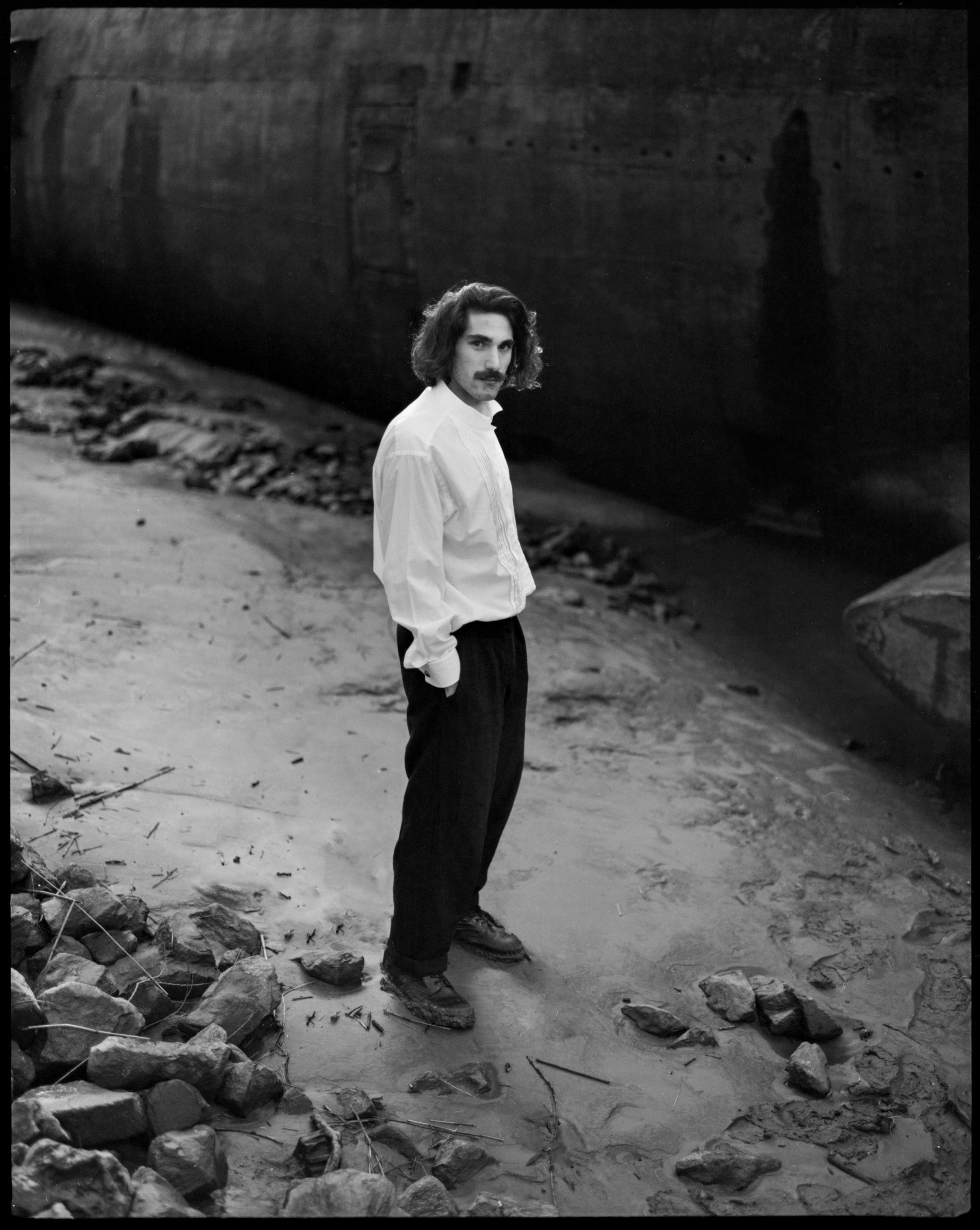 white, black, one person, black and white, monochrome photography, full length, darkness, adult, monochrome, standing, men, young adult, portrait, lifestyles, person, casual clothing, clothing, architecture