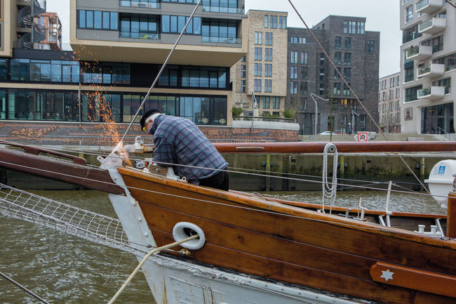 Architecture Boat Building Exterior Built Structure City Cleaning Day Fixed Men Moored Nautical Vessel Old One Person Outdoors People Real People Transportation Water