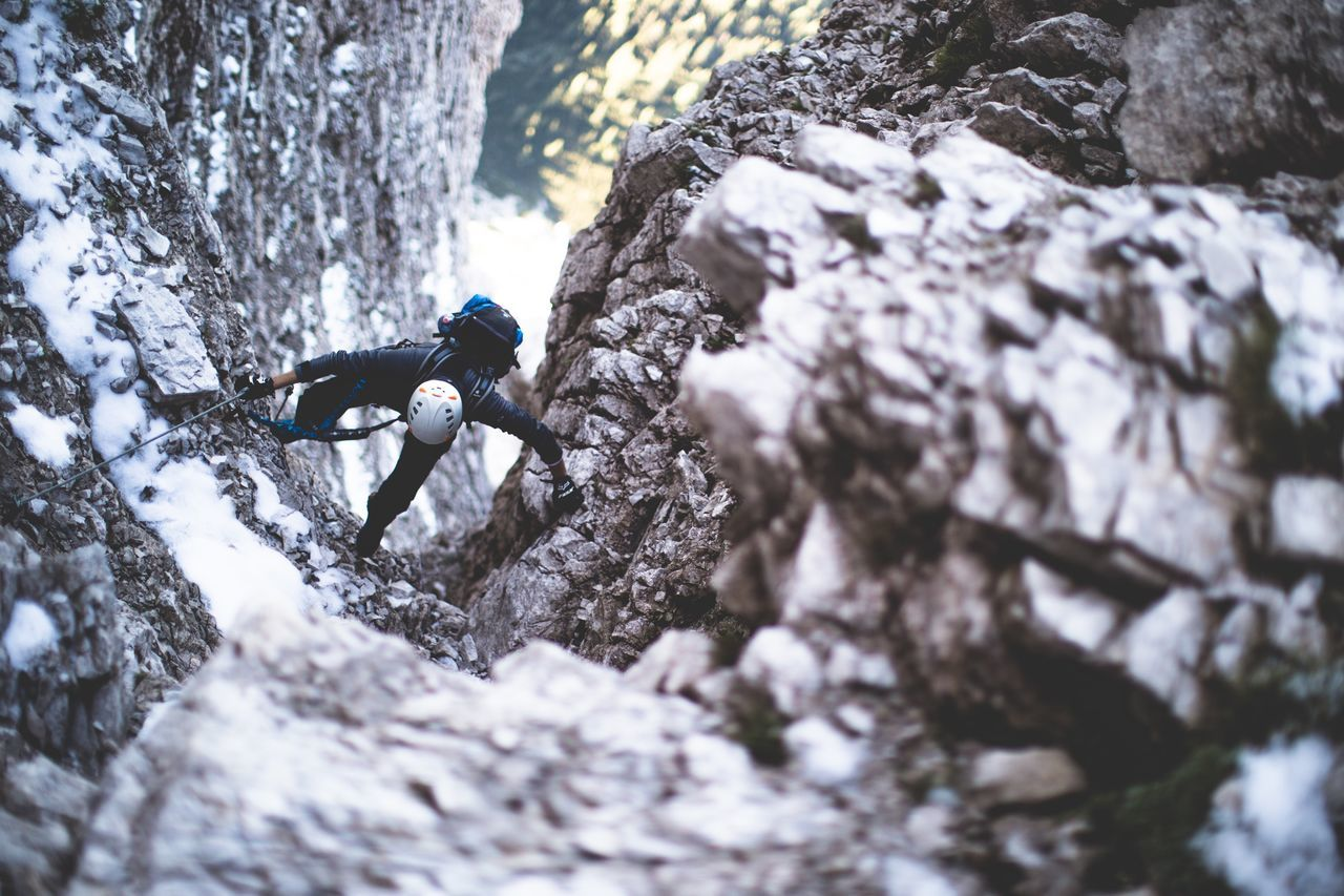 High angle view of man climbing rock