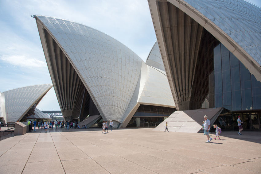 Sydney,NSW,Australia-November 20,2016: Modern Sydney Opera House architecture with tourists in Sydney, Australia. 20th Century Architecture Australia City Exploring Façade Modern Architecture Roof Rooftop Sydney Opera House Tourist Tourist Attraction  Bennelong Point Design Famous Place Geometric Landmark Pattern People And Places Real People Style Sydney Tourism Travel Destinations Walking