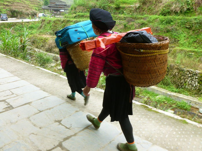Longsheng-China Transportation Adult Basket Carrier China Day Full Length Hikingadventures Outdoors People People And Places People Group People Photography Real People Rear View Togetherness Two People Walking Yao Minority