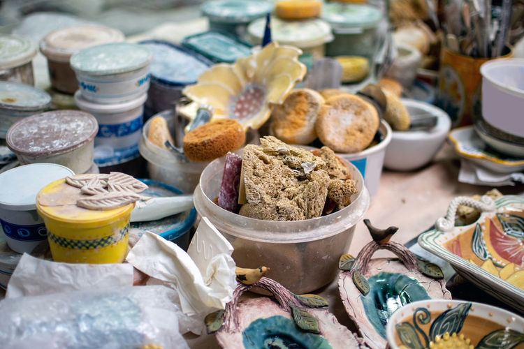 Brushes, sponges and containers of ceramic glazes are all part of this busy pottery shop