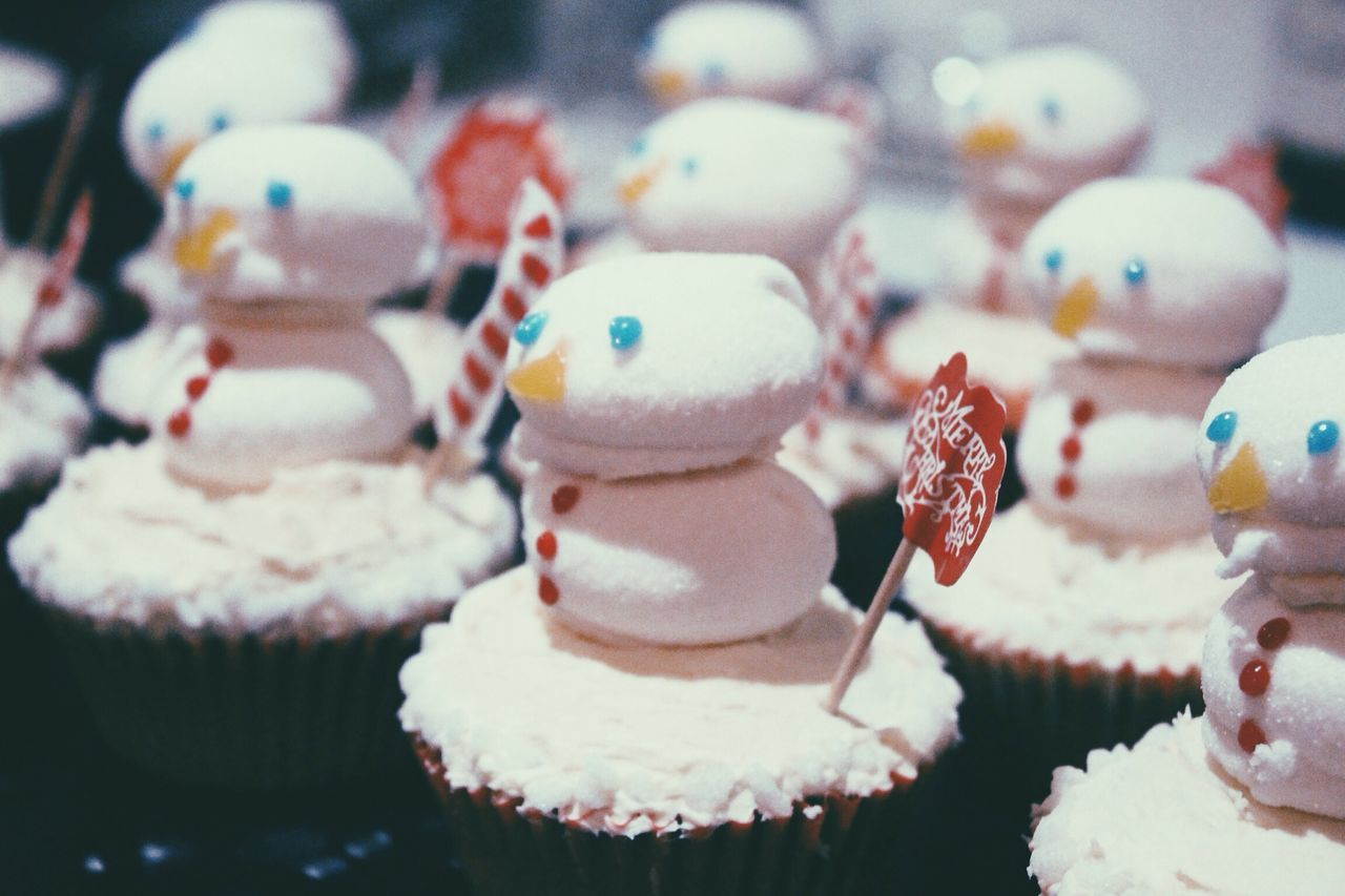 Snowman cupcake on display at store during christmas