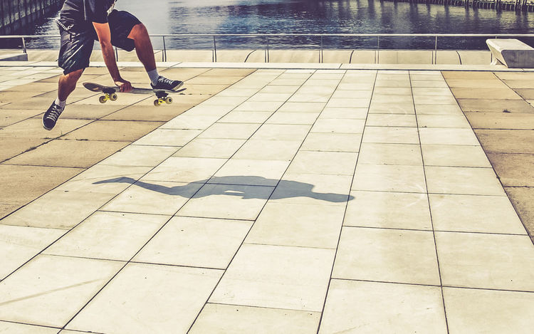 "The One-Leg-Shadow-Man Oldschool Skateboarding in the ""Hafencity"" of Hamburg Composing Free Germany Hafencity Hamburg Jump Oldschool One Leg Shadow Skateboard Skateboarding Trick"