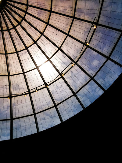 Blue sky with clouds behind a glass dome Sky Sky And Clouds Clouds Sun Sunlight Dome Cupola Window Water Backgrounds Pattern Close-up Architecture And Art Mausoleum Arched Stained Glass Architectural Design Architectural Detail Transparent Skylight Geometric Shape Office Building Square Shape