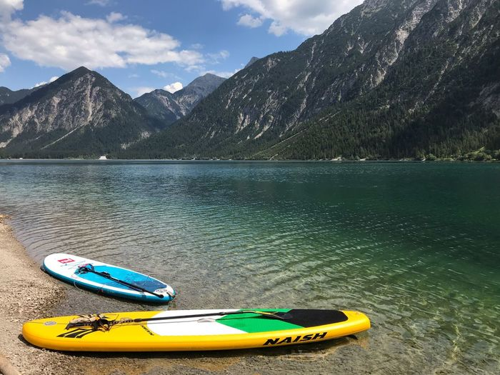 SUP Board Clear Water Lake Surfing Surfboard Stand Up Paddling Standuppaddle Sup Heiterwanger See Austria Water Mountain Lake Beauty In Nature Nature Sky Cloud - Sky Day Scenics - Nature Outdoors No People