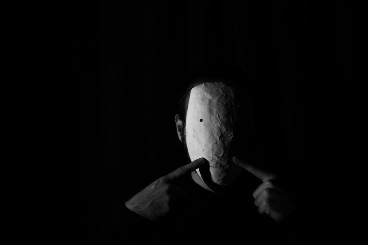 Portrait of man in mask