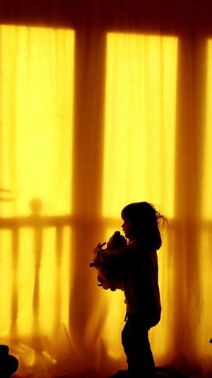 Indoors  Full Length Day Children Sundays Morning Childhood Girl Playing Toys Little Girl Child Scared Of The Monster Curtains 2 Years Old Window One Person Youthful Mothers Love Scared Side View Hiding Game England Daughter High Angle View