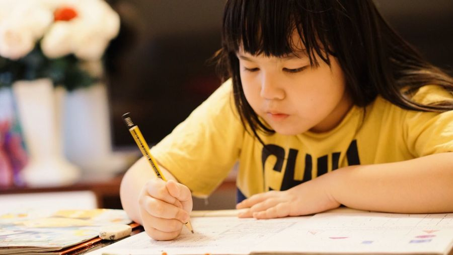 Close-Up Of Child Writing