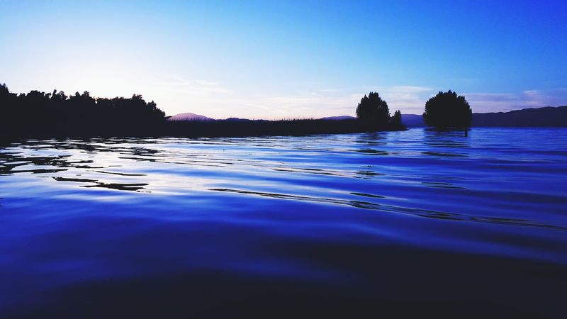 Serenity. Dawn Sunrise Hues Clearlake Ripple Water Relaxing Skies Mountain Range Blue Outdoors Peace And Quiet Taking A Break