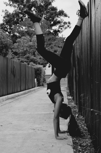 Blackandwhitephotography Photography Cheerleading Gymnastics Tumbling Full Length One Person Real People Young Adult Flexibility Handstand  Leisure Activity Lifestyles Exercising Outdoors Energetic Motion