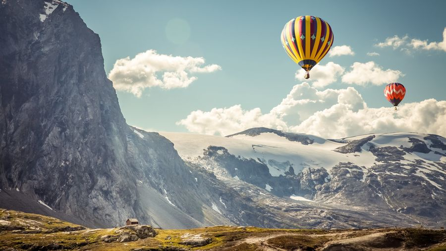 Hot Air Balloon Landscape Adventure Cloud - Sky Sunlight Mountain Outdoors Vacations Scenics Sky Nature People Day Adults Only Only Men Adult