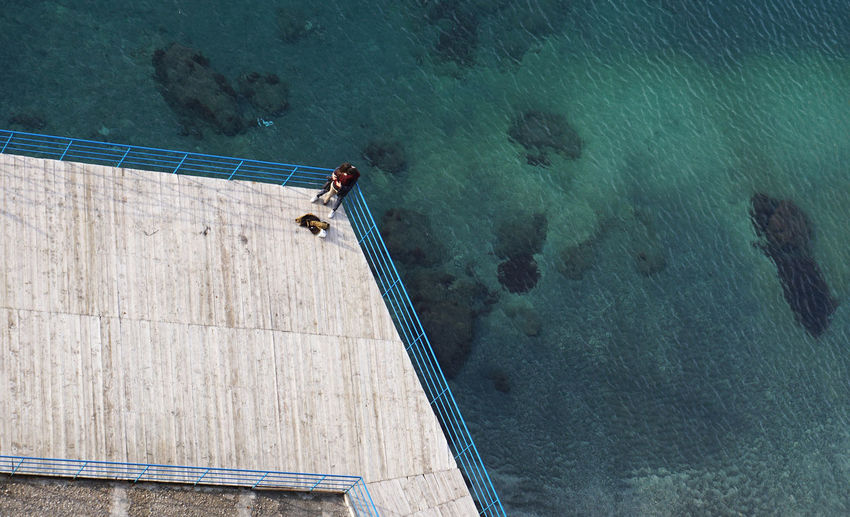 top view on a couple at the coast in Catalonia Amalfi Coast Birds Eye View Blue Calmness Couple A Bird's Eye View Holiday Italia Italien Italy Katalonien Liebe Liebespaar Mediterranean  Meer Mittelmeer Outdoors Paar Sea Tilt Shift Top Perspective Traveling
