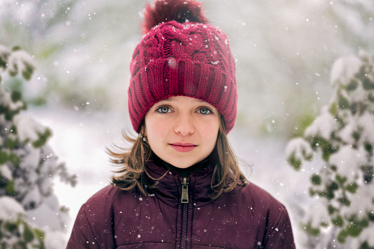 Portrait of cute girl wearing hat during winter