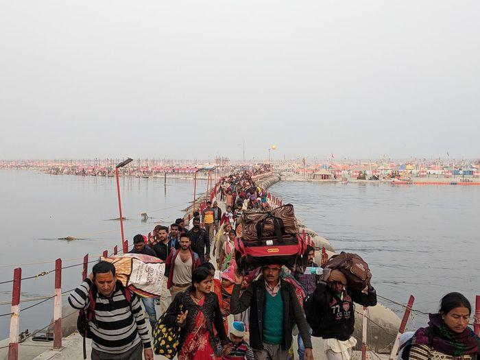 Kumbh Mela 2019 - World's Largest Gathering . People heading back after they took the holy dip in the Triveni Sangam on the day of Mauni Amavasya . #indiantraveller #sunset EyeEm Selects India Ritual NoEditNoFilter EyeEmNewHere Hindu Kumbh Bridge - Man Made Structure Gathering Religious  Ganga Yamuna Saraswati Triveni Sangam Water Sky Horizon Over Water