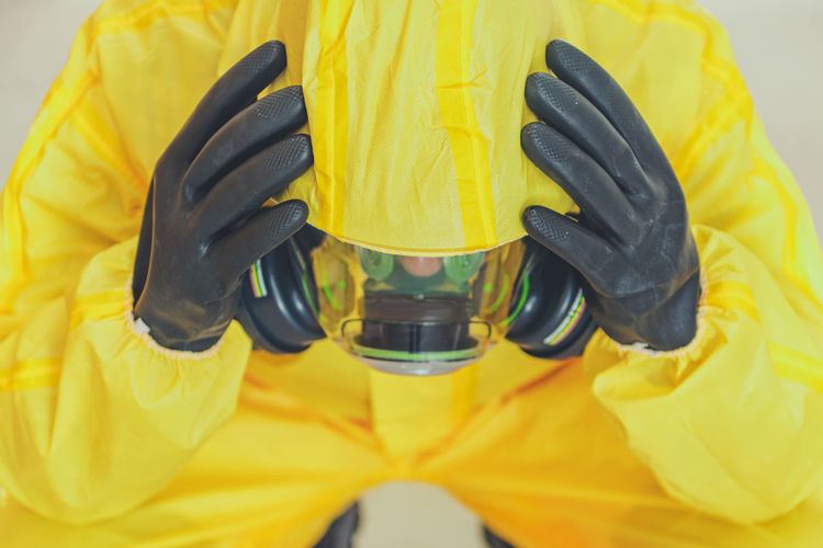 Depressed man wearing protective suit