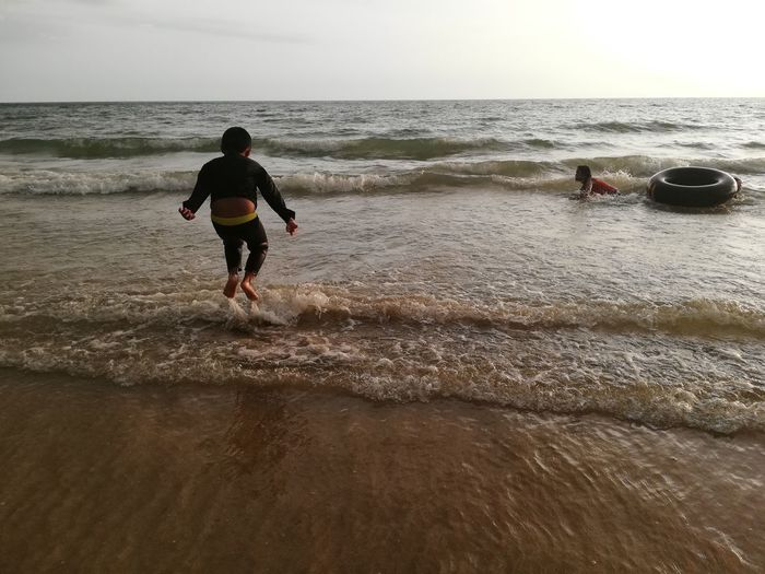 Children enjoy on summer trip 2019,หาดเจ้าหลาว Achi2019 Sea Water Sky Beach Land Horizon Over Water Horizon Leisure Activity Beauty In Nature Real People Scenics - Nature Rear View Motion Lifestyles Nature Holiday Wave Men People Outdoors