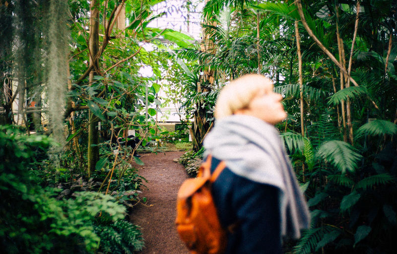 35mm Botanik VSCO Adult Backpack Beauty In Nature Flowers Forest Garden Girl Grain Jungle Leica Lifestyles Nature Outdoors People Plant Rear View Rucksack Tree Women The Week On EyeEm Editor's Picks Stories From The City