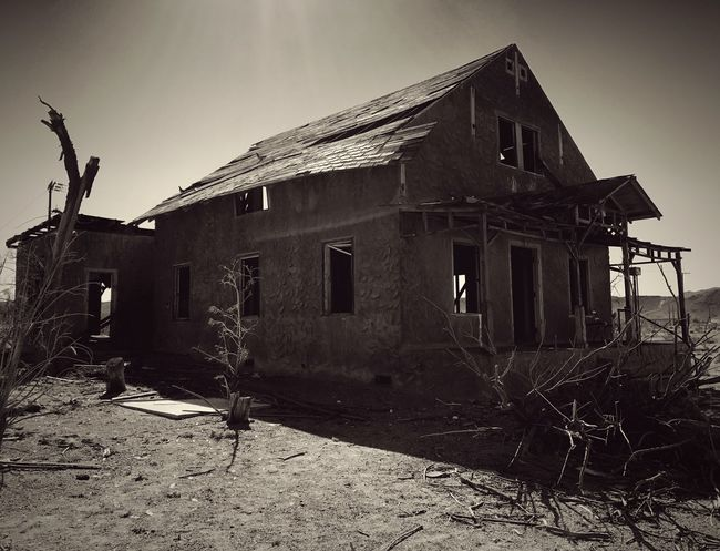 """""""Dead On '66"""" An abandoned old building, a victim of the Mojave Desert and the spirits past of Route 66, sits decaying in the ghost town of Ludlow, California. Architecture Abandoned Roadside America Travel Photography Desolate Scene Route 66 Ghost Town Old Buildings Mojave Desert Abandoned & Derelict Abandoned Buildings Historic Route 66 Blackandwhite Blackandwhite Photography"""