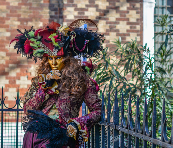 Portrait of woman dressed up for carnival at yard