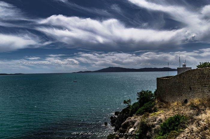 Faro e Monte Argentario in lontananza Architecture Beauty In Nature Building Exterior Built Structure Cloud - Sky Day Horizon Over Water Mountain Nature No People Outdoors Scenics Sea Sky Tranquility Water Lost In The Landscape