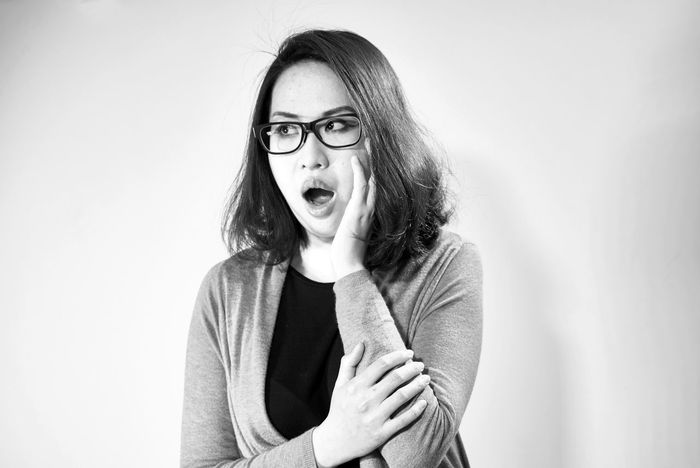 Asian woman, surprised expression Adult Adults Only Boggle Close-up Eyeglasses  Females Horn Rimmed Glasses Horrify Horrifying Human Body Part Indoors  One Person One Woman Only One Young Woman Only Only Women People Portrait Startled Studio Shot Terrifying White Background Women Young Adult Second Acts