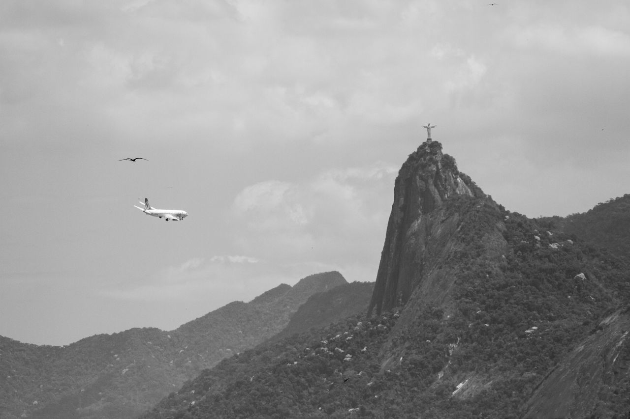 flying, mountain, mid-air, sky, nature, day, bird, outdoors, scenics, beauty in nature, low angle view, no people, animal themes, spread wings