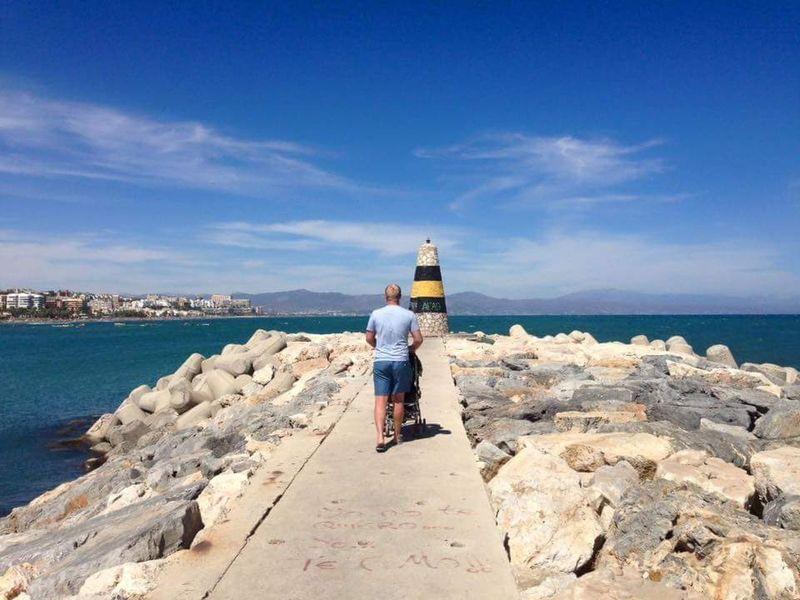 Lighthouse Sea Beach Rear View One Person Summer Sand Water Travel Destinations Vacations Fatherhood Moments Benalmadena Marina Benalmádena, Malaga, Spain Benalmádena