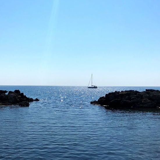 Water Sea Sky Beauty In Nature Copy Space Scenics - Nature Horizon Over Water Clear Sky Nature Tranquility Blue Tranquil Scene Horizon No People Waterfront Yacht Sailboat Day Nautical Vessel