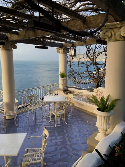 Overlooking the sea Terrace Terrazza Sorrentocoast Amalficoast Italy Sorrento Chair Seat Built Structure No People Outdoors Tourist Resort Building Exterior