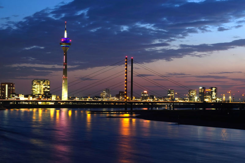 The skyline of Düsseldorf. Architecture Bridge - Man Made Structure Building Exterior Built Structure City Cityscape Cloud - Sky Harbor Illuminated Nautical Vessel Night No People Outdoors Reflection River Sky Skyscraper Suspension Bridge Tower Travel Destinations Urban Skyline Water Waterfront Your Ticket To Europe