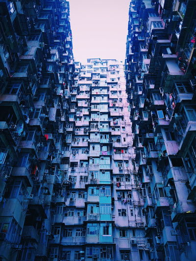 Low angle view of residential buildings in city against sky
