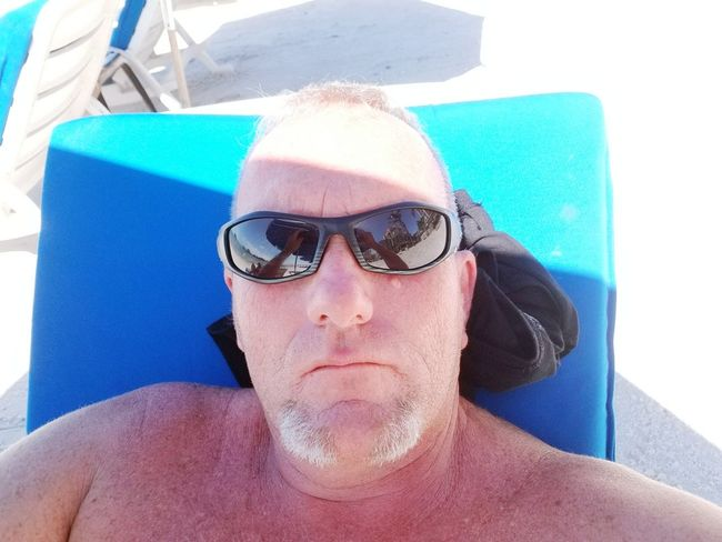 One Man Only Water Only Men Swimming Pool Sunglasses Leisure Activity One Person Front View Day Wet Headshot Outdoors Towel Adult Adults Only People Lifestyles Human Body Part Portrait Men