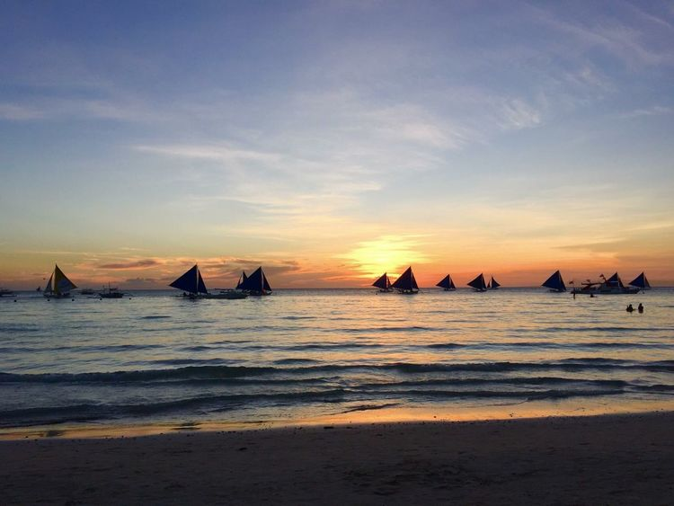 Love the people Philippines Boracay Sunset Beach Sea Sunset Water Sand Beauty In Nature Scenics Nature Sky Tranquil Scene Horizon Over Water Tranquility No People Wave Outdoors Day Cloud - Sky EyeEmNewHere An Eye For Travel