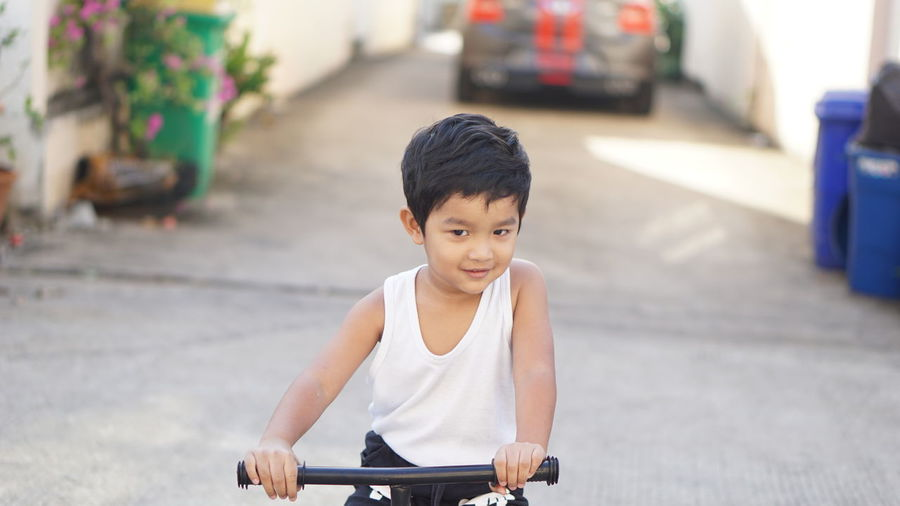 Boy looking at bicycle