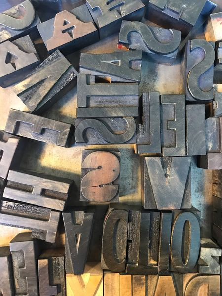 Metal type showing various letters of the alphabet Still Life Bold Typeface  Typography Typography & Design Metal Type Full Frame Large Group Of Objects Backgrounds Abundance No People Still Life Text High Angle View Arrangement Directly Above Pattern Variation Indoors  Choice Close-up Letter Metal Alphabet
