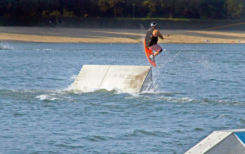 Cable wake boarding is awesome summer sport Athlete Fun Cablewakeboarding Day Extreme Sports Lake Men One Person Outdoors Summer Wakeboarding Water Watersports
