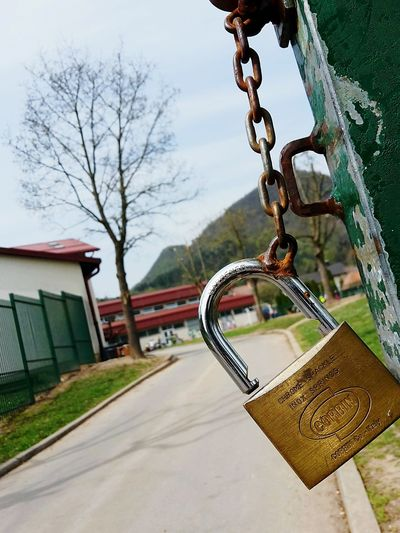 EyeEmNewHere Metal Outdoors Lock Chain Hanging Day No People Close-up Tree Sky