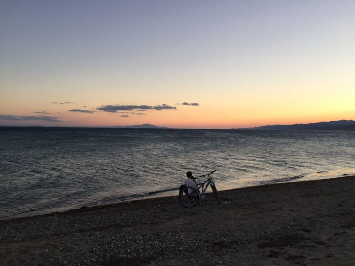 Sunset Bicycle Transportation Mode Of Transport Sea Nature Beauty In Nature Beach Tranquil Scene Silhouette Water Nature Yasaminkaresi Leben Scenics Tranquility Stationary Sky Outdoors Land Vehicle No People Horizon Over Water Clear Sky Sommergefühle Lost In The Landscape Second Acts EyeEmNewHere EyeEmNewHere