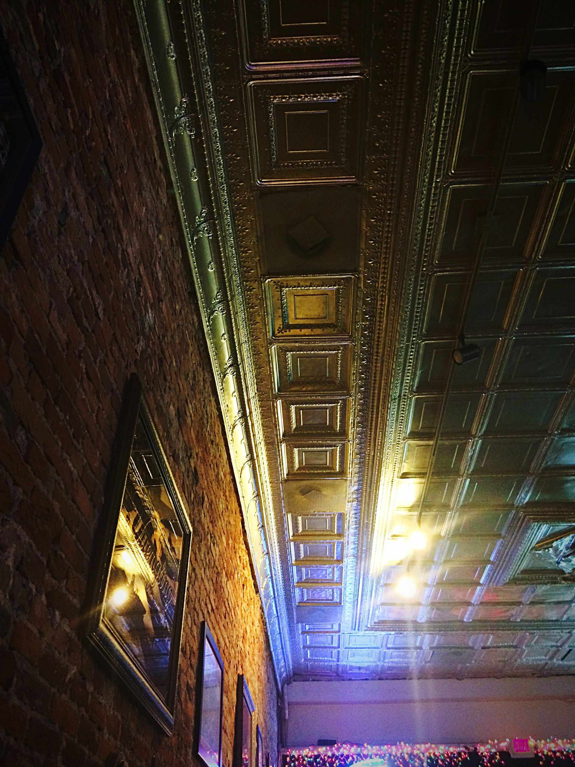 illuminated, built structure, architecture, night, lighting equipment, the way forward, indoors, steps and staircases, railing, diminishing perspective, steps, ceiling, light - natural phenomenon, vanishing point, high angle view, building exterior, staircase, no people, transportation, railroad track