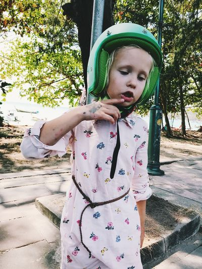 Child Childhood One Person Real People Girls Leisure Activity Cute Females Innocence Front View Lifestyles Day Women Casual Clothing Tree Looking Standing Plant Outdoors Floral Pattern