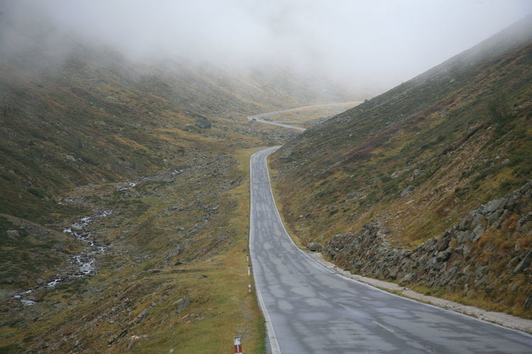 Europe, Austria. Road Scenics - Nature Non-urban Scene Mountain Road Day Mountain Transportation Beauty In Nature Environment No People Tranquility Nature Tranquil Scene Landscape Direction Fog The Way Forward Remote Outdoors Winding Road