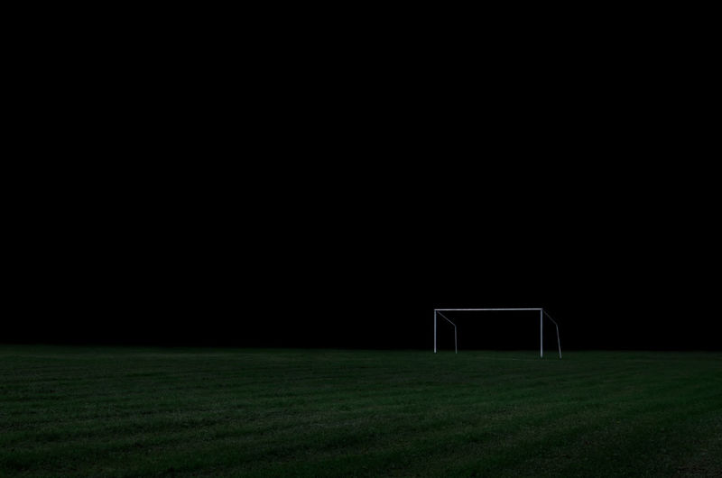 Scenic view of soccer field at night