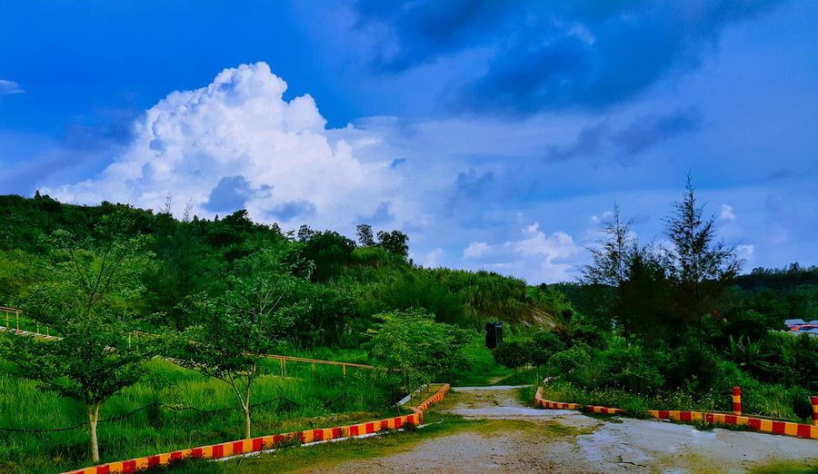 The beauty of my workplace- Road to the water reservoirs! Check This Out My Commute Landscape Landscape_photography Hills Sky Nature Clouds And Sky Clouds Road Leading Line Bangladesh