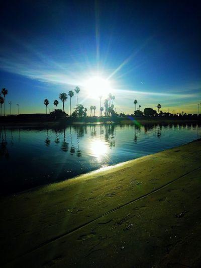 Silhouette Reflection Sunlight Sun Water Sky Outdoors