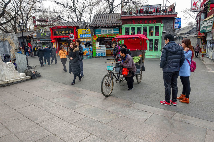 BEIJING, CHINA Tourists in a rickshaw in a hutong, Ancient hutongs are formed by alleys that represent an important cultural element of the city of Beijing ASIA Ancient Architecture Asian  Beijing Beijing, China City Cityscape Exotic Markets Rickshaw Run Road Tourists Travel Bicycle China Culture Group Of People History Hutong Street Tourism Town Traditional Urban