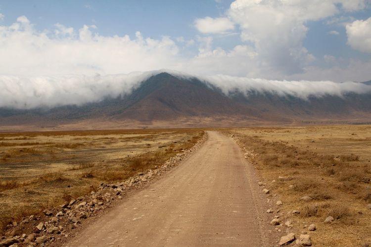 Dirt road passing through a desert